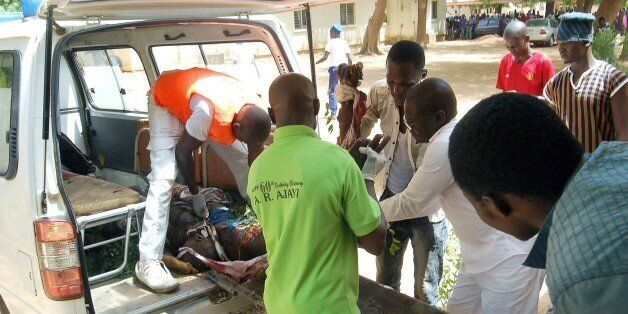 **GRAPHIC CONTENT**Health officials carry the body of a victim of a suicide bomb attack out of an ambulance...