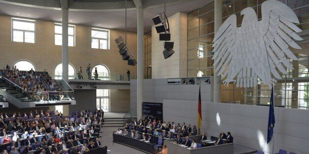 German Chancellor Angela Merkel delivers a speech during a session at the Bundestag lower house of parliament...