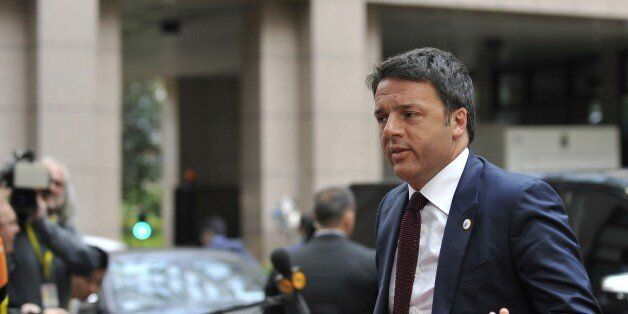 Italian Prime Minister Mateo Renzi arrives for a meeting in Brussels of the leaders of the 19 countries...
