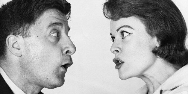 Side profile of a young woman shouting on a young man