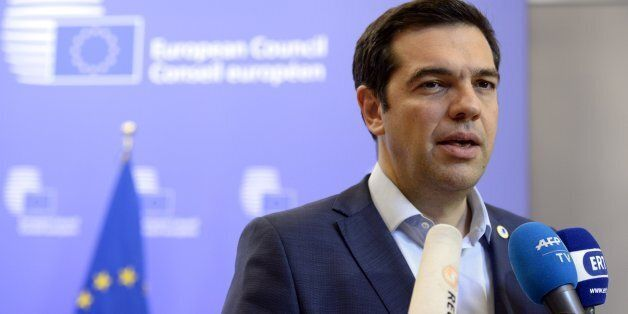 Greek Prime Minister Alexis Tsipras talks to the media at the end of an Eurozone Summit over the Greek...
