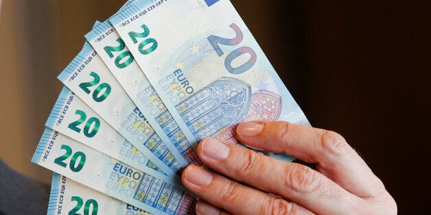 New 20 Euro bank notes are displayed in Frankfurt, Germany, Wednesday, March 4, 2015. The banknote with...