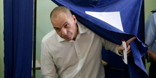 Greece's Finance Minister Yanis Varoufakis casts his vote at a polling station in Athens, Sunday, July...