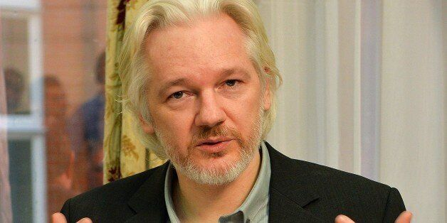 WikiLeaks founder Julian Assange gestures during a press conference inside the Ecuadorian Embassy in...
