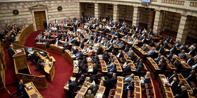 Greek Lawmakers attend an emergency Parliament session for the government's proposed referendum in...