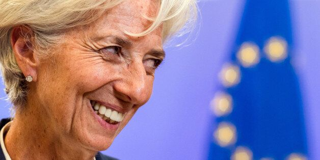 Managing Director of the International Monetary Fund Christine Lagarde smiles as she leaves after a meeting...