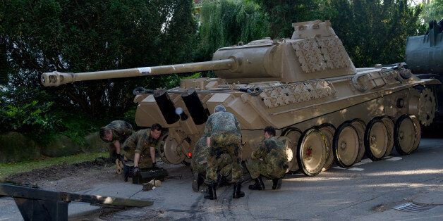 In this July 2, 2015 picture a World War II -era Panther tank is prepared for transportation from a residential...