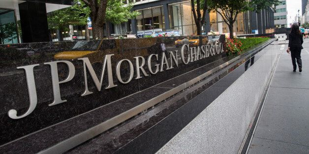 NEW YORK, NY - AUGUST 12: A woman walks past JP Morgan Chase's corporate headquarters on August 12, 2014...