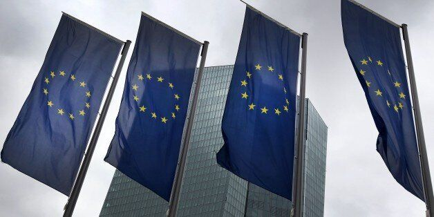 European flags flutter in front of the headquarters of the European Central Bank (ECB) in Frankfurt am...