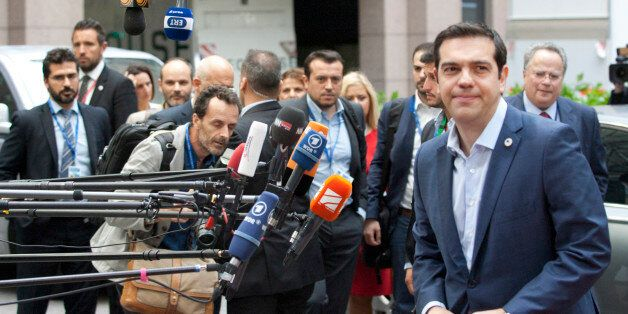 Greek Prime Minister Alexis Tsipras arrives for a meeting of eurozone heads of state at the EU Council...