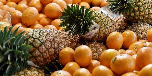 A picture taken on April 15, 2015 shows clementines, oranges and pineapples on display at the Talensac...