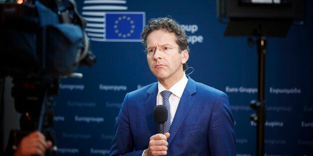 Dutch Finance Minister and chair of the eurogroup Jeroen Dijsselbloem listens to reporters in the Dutch...