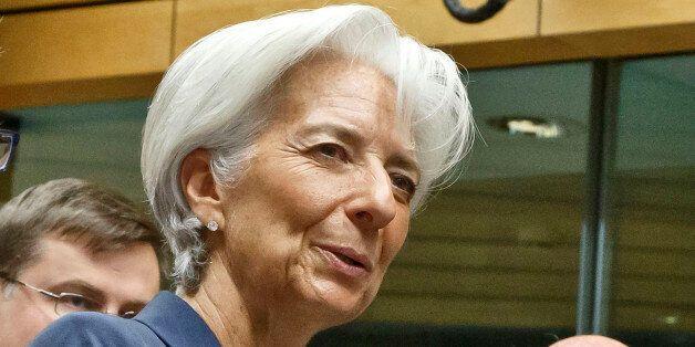 Finnish Finance Minister Alexander Stubb left, Managing Director of the International Monetary Fund Christine...