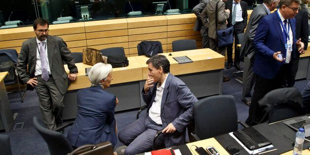 Greek Finance Minister Euclid Tsakalotos. center right, speaks with Managing Director of the International...