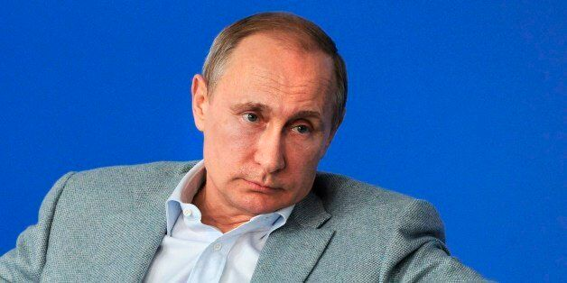 Russian President Vladimir Putin meets with participants in the youth educational forum in the Dvoriki...