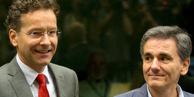 Dutch Finance Minister and chair of the eurogroup Jeroen Dijsselbloem, left, speaks with Greek Finance...