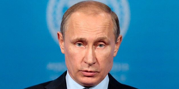 Russian President Vladimir Putin speaks at a news conference after the Shanghai Cooperation Organization...