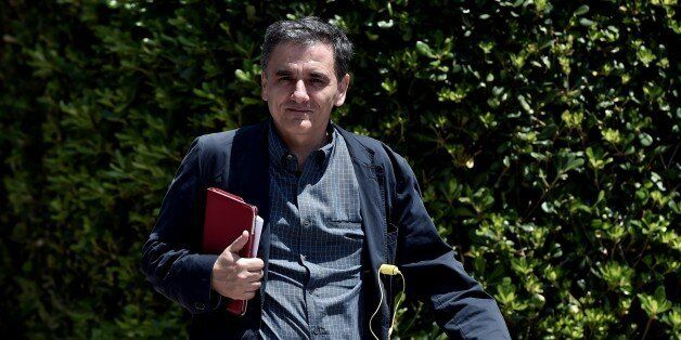 Greek minister of International Economic Relations Euclidis Tsakalotos arrives for a meeting at the Prime...