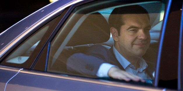 Greek Prime Minister Alexis Tsipras leaves in his car after a meeting at EU headquarters in Brussels...