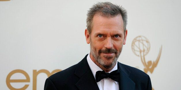 Hugh Laurie arrives at the 63rd Primetime Emmy Awards on Sunday, Sept. 18, 2011 in Los Angeles. (AP Photo/Chris
