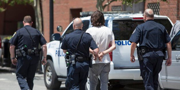 BOSTON, MA - JUNE 24: A man is taken into custody after a meat cleaver was found in his car in front...