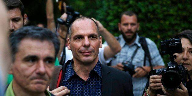 Greece's Finance Minister Yanis Varoufakis, center, and Deputy Foreign Minister for international economic...
