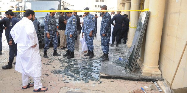 Security forces work at the site of a deadly blast claimed by the Islamic State group that struck worshippers...