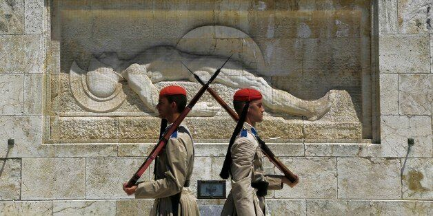 Evzones of Greek Presidential Guards are seen during changing of the guard at the tomb of the unknown...