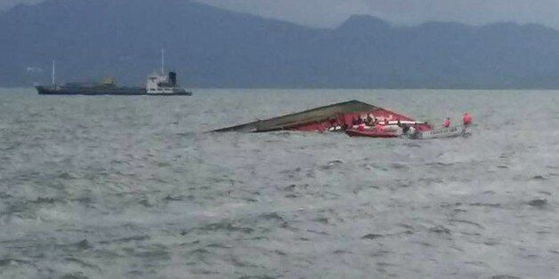 Rescuers search for survivors next to the capsized passenger ferry off Ormoc City, central Philippines...
