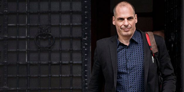 Greek Finance Minister Yanis Varoufakis leaves Maximos Mansion in Athens, Sunday, June 28, 2015. The...