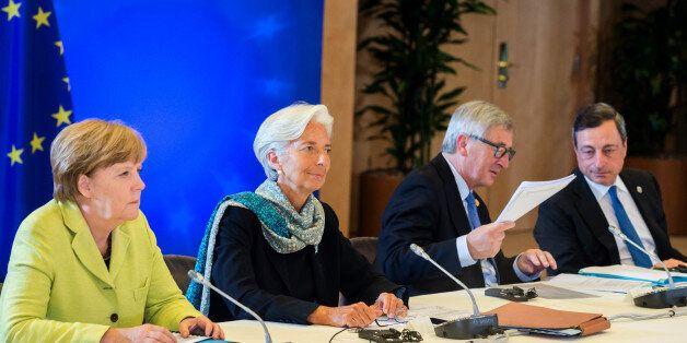 From left, German Chancellor Angela Merkel, Managing Director of the International Monetary Fund Christine...
