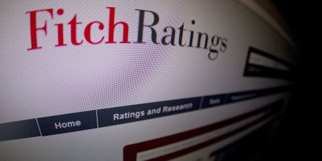 This picture taken on January 17, 2012 in Paris shows a close-up of a page of the Ratings agency Fitch...