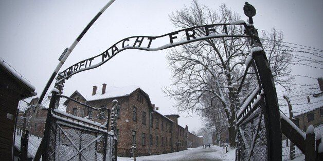 The entrance to the former Nazi concentration camp Auschwitz-Birkenau with the lettering 'Arbeit macht...