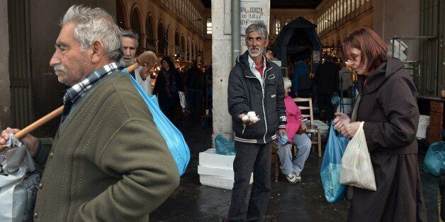 A man sells garlic on March 4, 2015 at a market in the center of Athens central market. Greece on March...