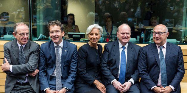 Managing Director of the International Monetary Fund Christine Lagarde, center, talks with Dutch Finance...