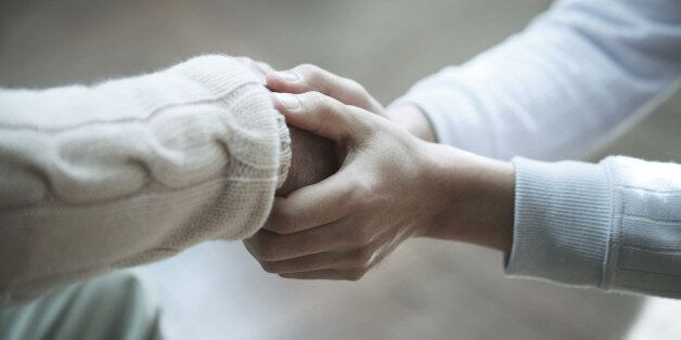 Senior man and son,hands
