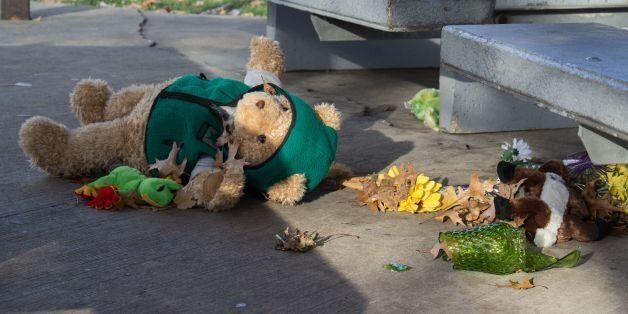 A stuffed animal lays on the ground at the Cudell Commons Park in Cleveland, Ohio, November 24, 2014...