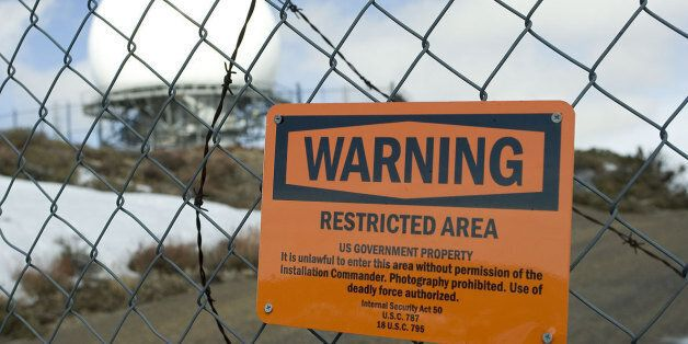 Deadly force is authorized against trespassers on this government property. The sign on this fence is...