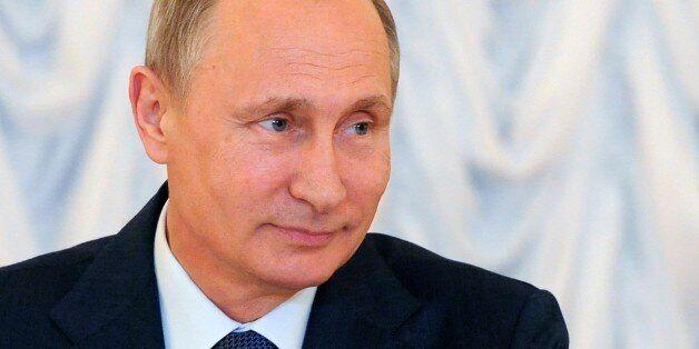 Russian President Vladimir Putin meets with investors at an economic forum in St. Petersburg, Russia,...