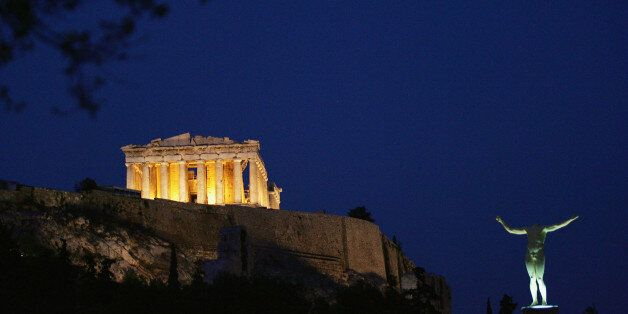 ATHENS - AUGUST 13: The sun sets over the Parthenon on the eve of Athens 2004 Olympic Games during the...