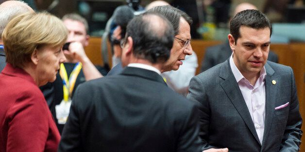 From left, German Chancellor Angela Merkel, French President Francois Hollande, Cypriot President Nicos...