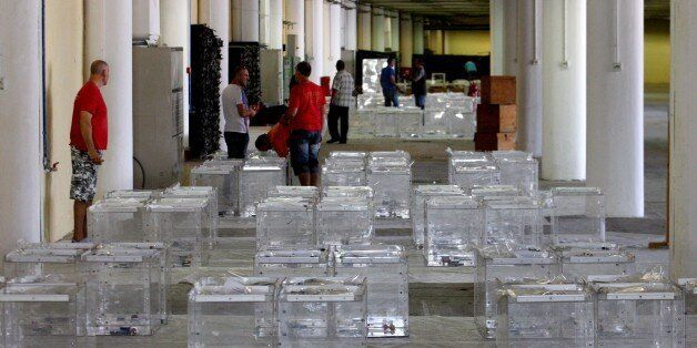 Electoral workers prepare ballot boxes in a warehouse in Thessaloniki on July 2, 2015, ahead of a controversial...