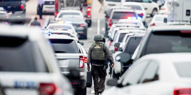 A large police presence gathers along M St. in Southeast Washington, Thursday, July 2, 2015, after an...