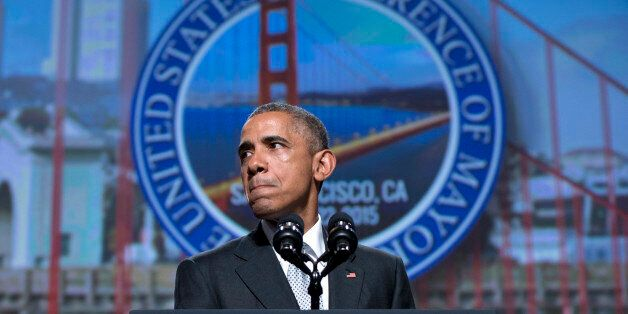 In this June 19, 2015, photo, President Barack Obama pauses as he speaks about gun violence at the Annual...