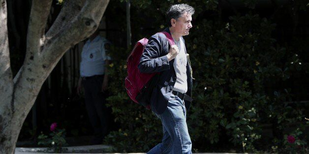 Greek minister of International Economic Relations Euclid Tsakalotos arrives for a cabinet meeting at...