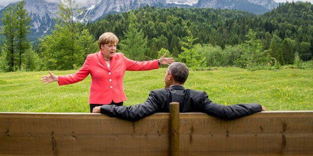 German chancellor Angela Merkel speaks with U.S. president Barack Obama at Schloss Elmau hotel near Garmisch-Partenkirchen,...