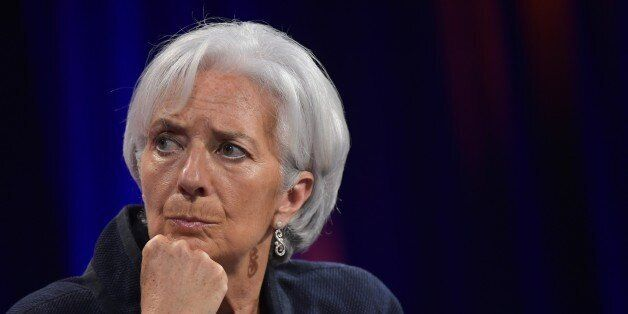International Monetary Fund Managing Director Christine Lagarde listens as Federal Reserve Board Chairwoman...