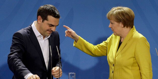 German Chancellor Angela Merkel, right, points as she and the Prime Minister of Greece Alexis Tsipras...