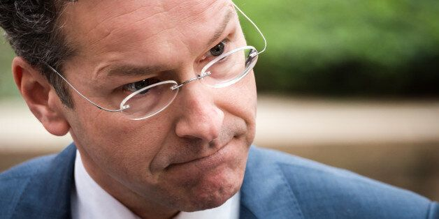 Dutch Finance Minister Jeroen Dijsselbloem talks with journalists as he arrives for a meeting of eurogroup...