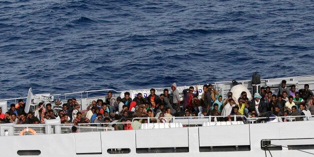Rescued migrants are seen aboard the Monte Sperone ship of the Italian border police in the Mediterranean...